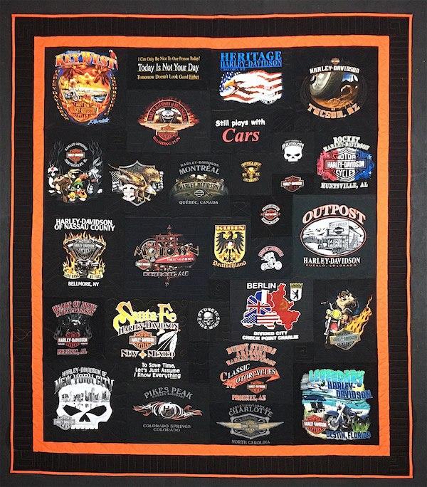 A black T-shirt quilt with an orange border.