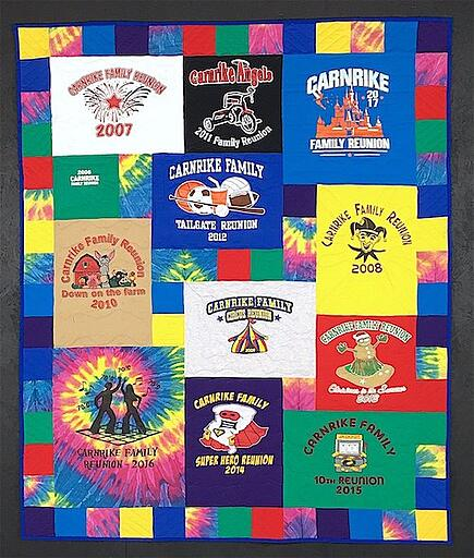 T-shirt quilt with a tie-dye and solid color pieced border.
