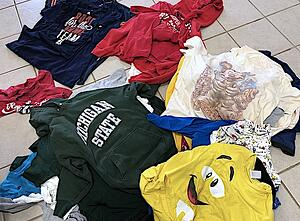categories of T-shirts in piles on the floor for a T-shirt Quilt