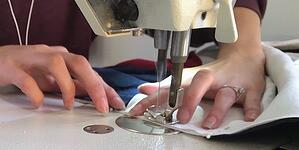 someone sewing a T-shirt quilt.