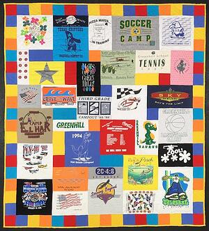 """colorful fun summer feel to this T-shirt quilt with a colorful 4"""" pieced border."""