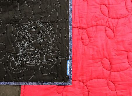 compare quilting on a Too Cool T-shirt quilt (black) with a campus quilt (pink)