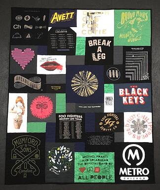 A concert T-shirt quilt where the green and white shirts are balanced with the black T-shirts.
