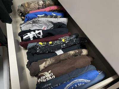 dresser drawer of T-shirts you need a quilt