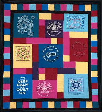 a photo of a T-shirt quilt taken flat on a stage.