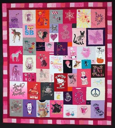 A little girl T-shirt quilt with a pink border