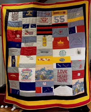 Quilt made by an inexperience T-shirt quilt maker.