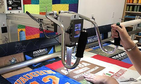 long-arm quilting working from the front of the machine.