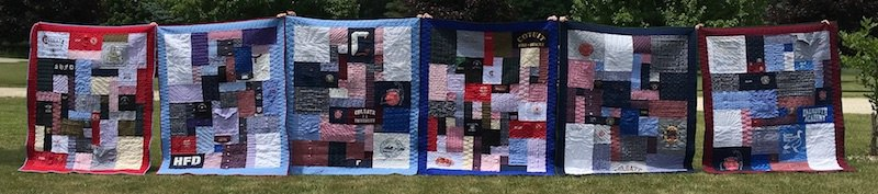 6 memorial quilts made from clothing lined up