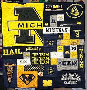 U of M T-shirt quilt with one gigantic block that dominates the quilt.