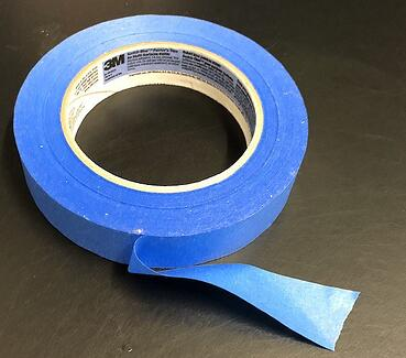 This is blue painters tape. This is the best take to use for marking direction on your T-shirts for your quilt maker.