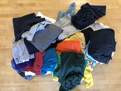 A pile of t-shirts for a T-shirt quilt