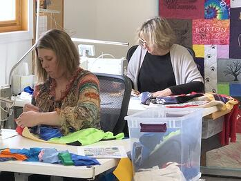 skilled t-shirt quilt maker at Too Cool T-shirt Quilts