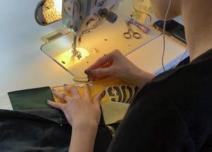 Sewing a T-shirt quilt.