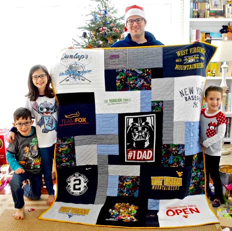 Happy family with T-shirt quilt.