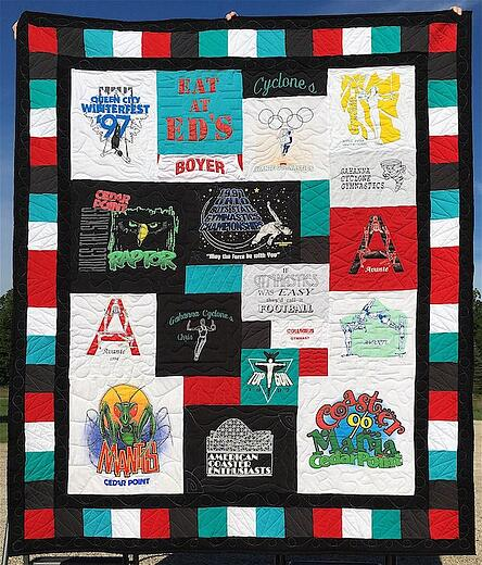 A T-shirt quilt with a triple border. Pieced + solid.