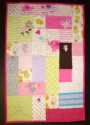 """The quilt here is made from baby clothes. The size is 24"""" x 36""""."""