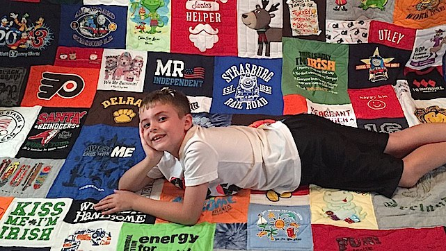 Boy enjoying his T-shirt Quilt